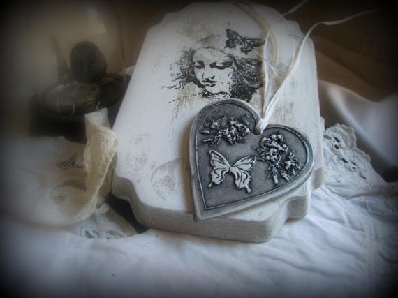 decorations-murales-coeur-papillon-en-terre-cuite-ema-4956823-photo-2377-e0286_570x0